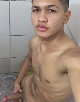 Latino boy taking a nude selfie