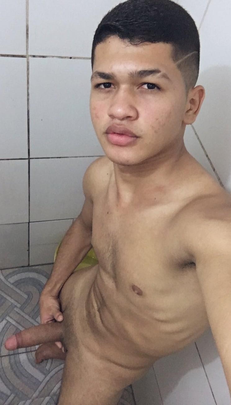 Latino boy taking a nude selfie