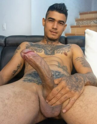 Tattooed boy with a big dick